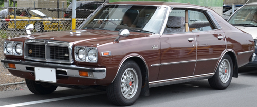 1978–79 Nissan Laurel (C230) 2800SGL four-door hardtop front 3q © 2013 Ypy31 (PD CC0 1.0 PD - modified by Aaron Severson)