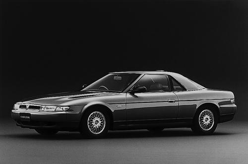 1990 Eunos Cosmo front 3q press - copyright Mazda