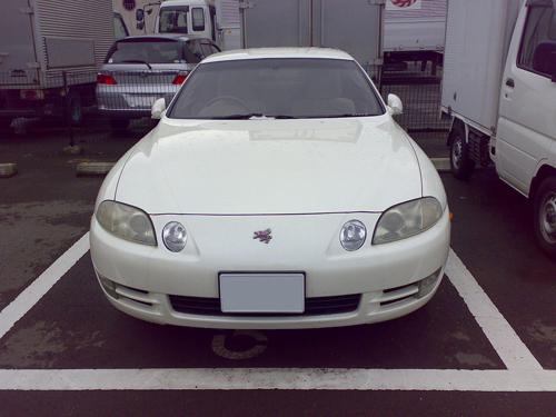 1996 Toyota Soarer 3.0GT (JZZ31) front © 2007 Masayuki Kawagishi (CC BY 2.0 Generic - modified by Aaron Severson)